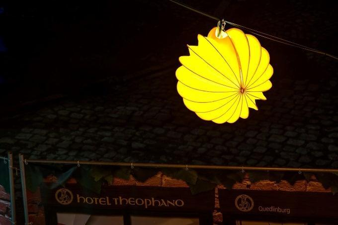The weatherproof and robust lampion Barlooon in yellow in size M during Advent in the courtyards in Quedlinburg Christmas lighting.