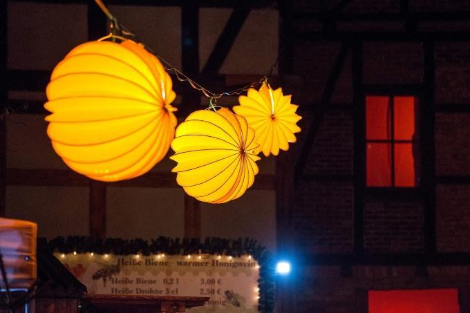 The weatherproof and robust lampion Barlooon in yellow during Advent in the courtyards in Quedlinburg Christmas lighting.
