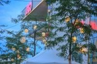The weatherproof and robust lampion Barlooon at the Lago-Center in Konstanz in the colour white mounted in the trees.