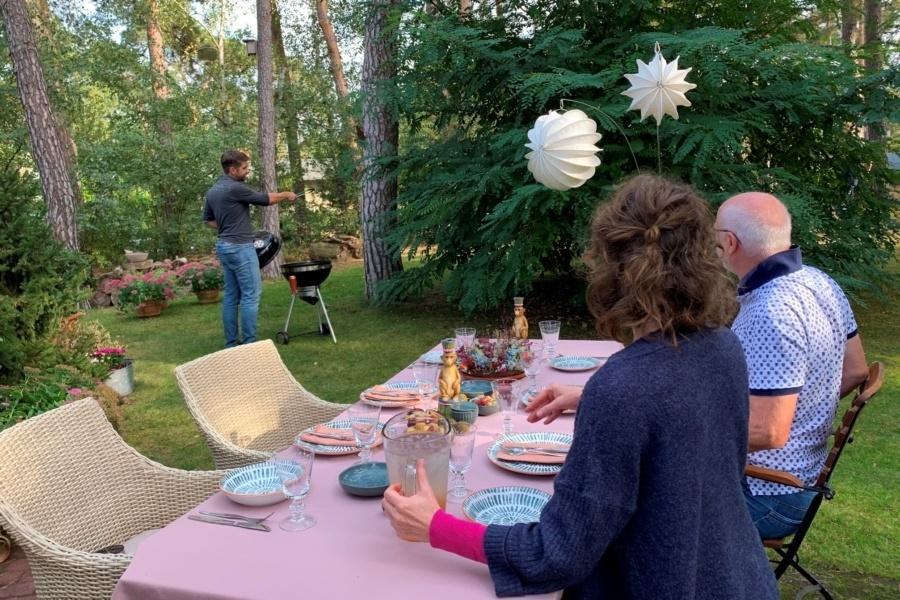 Weatherproof outdoor lampion Barlooon white at the garden party.