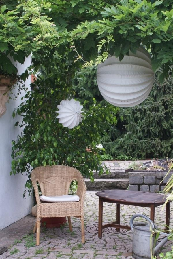 Weatherproof and robust outdoor lampion Barloon in white as seating decoration.